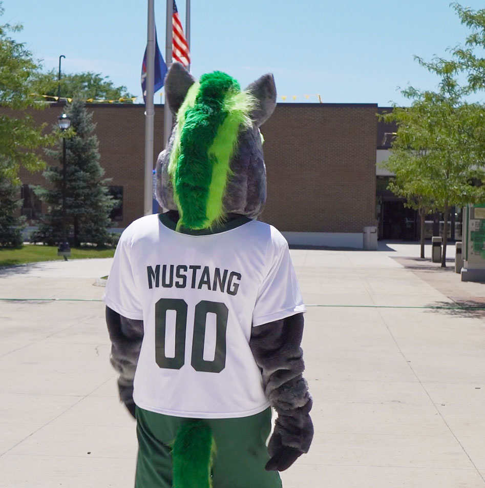 SUNY Morrisville Mascot Mo walks through the Admin Quad