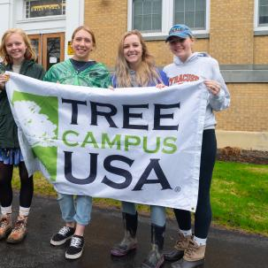 Students celebrate receiving a prior Tree Campus USA® recognition by the Arbor Day Foundation.