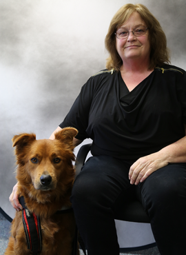 Clare Armstrong-Seward and her service dog